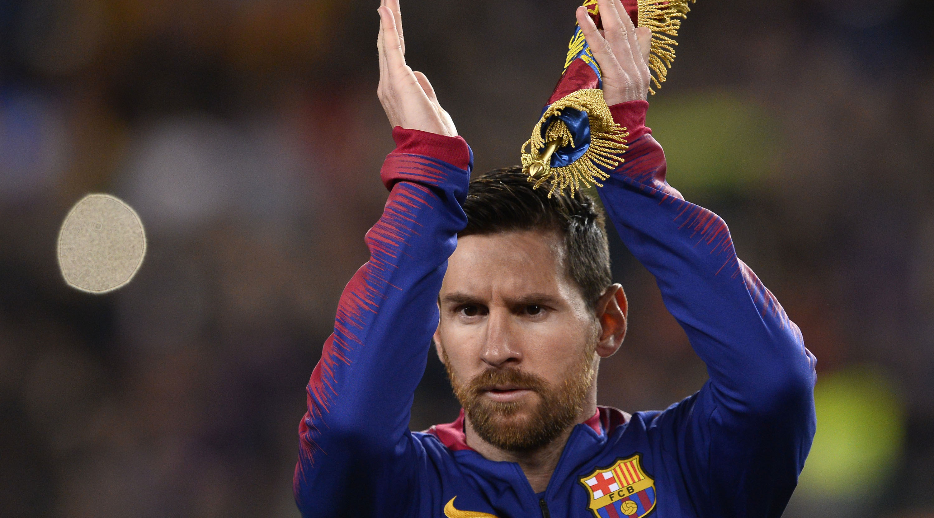 Barcelona's Argentinian forward Lionel Messi celebrates after scoring during the UEFA Champions League round of 16, second leg football match between FC Barcelona and Olympique Lyonnais at the Camp Nou stadium in Barcelona on March 13, 2019. (Photo by PAU BARRENA / AFP) (Photo credit should read PAU BARRENA/AFP/Getty Images)