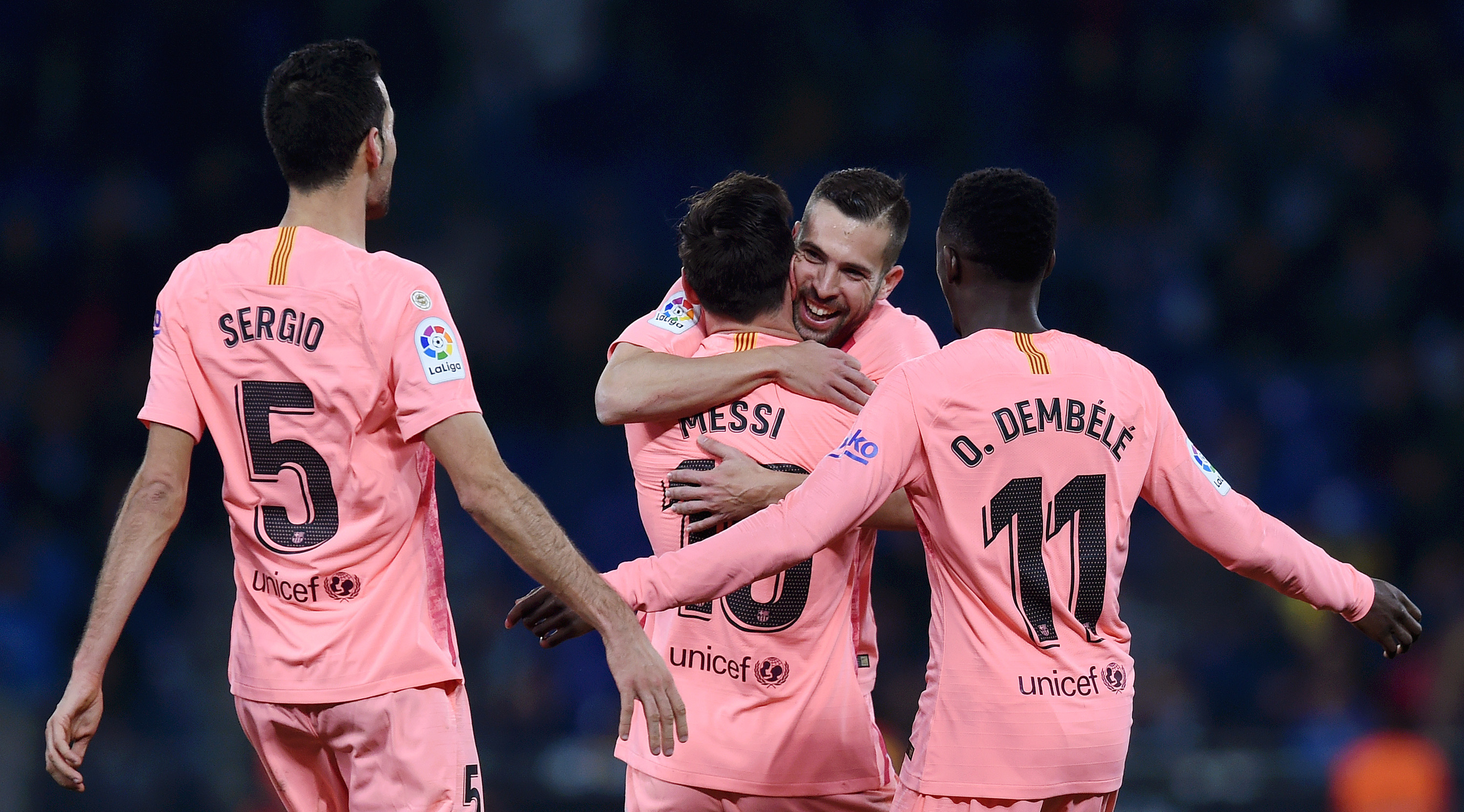 Lionel Messi of Barcelona celebrates with teammates after scoring his team's fourth goal during the La Liga match between RCD Espanyol and FC Barcelona at RCDE Stadium on December 8, 2018 in Barcelona, Spain. (Photo by Alex Caparros/Getty Images)