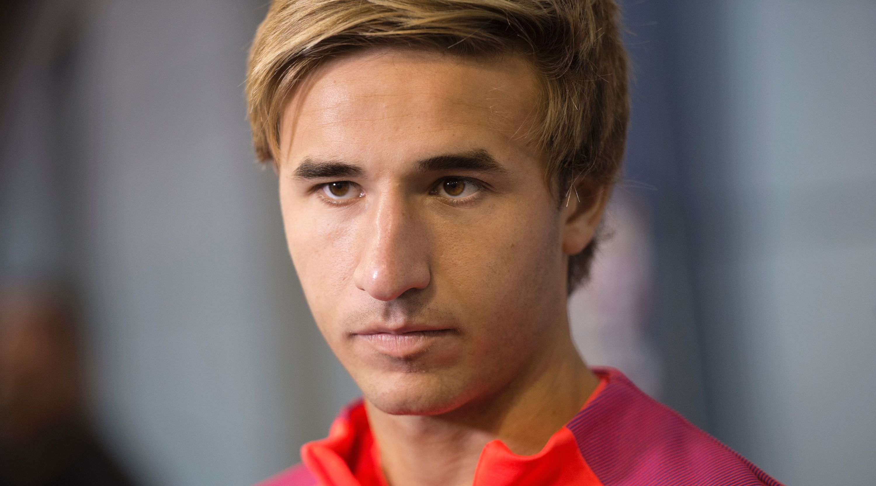 Barcelona's Spanish midfielder Sergi Samper is interviewed following a team training session at St George's Park near Burton-on-Trent, central England, on July 28, 2016.
