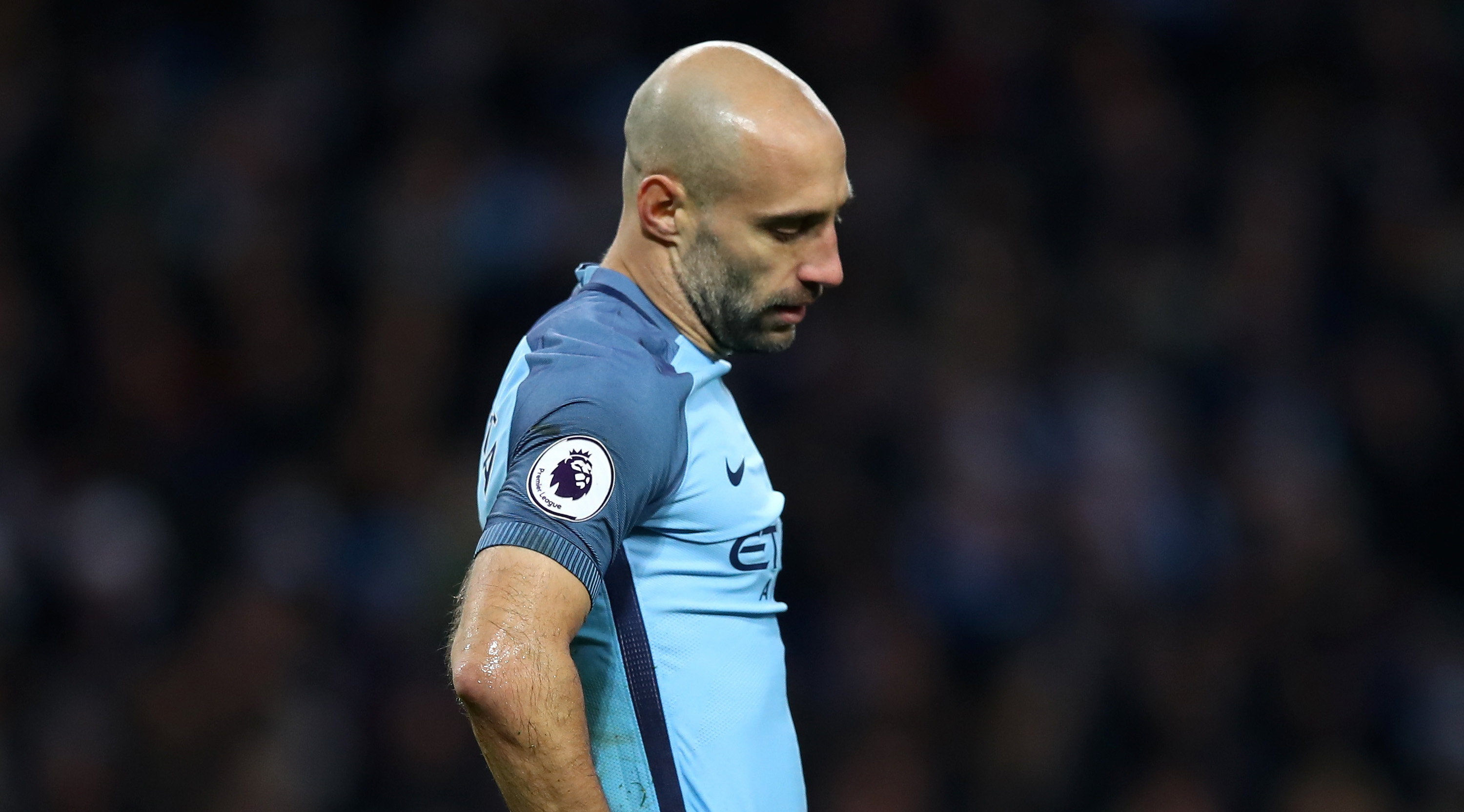MANCHESTER, ENGLAND - DECEMBER 18: Pablo Zabaleta of Manchester City is dejected after Arsenal score their first goal during the Premier League match between Manchester City and Arsenal at the Etihad Stadium on December 18, 2016 in Manchester, England. (Photo by Clive Brunskill/Getty Images)