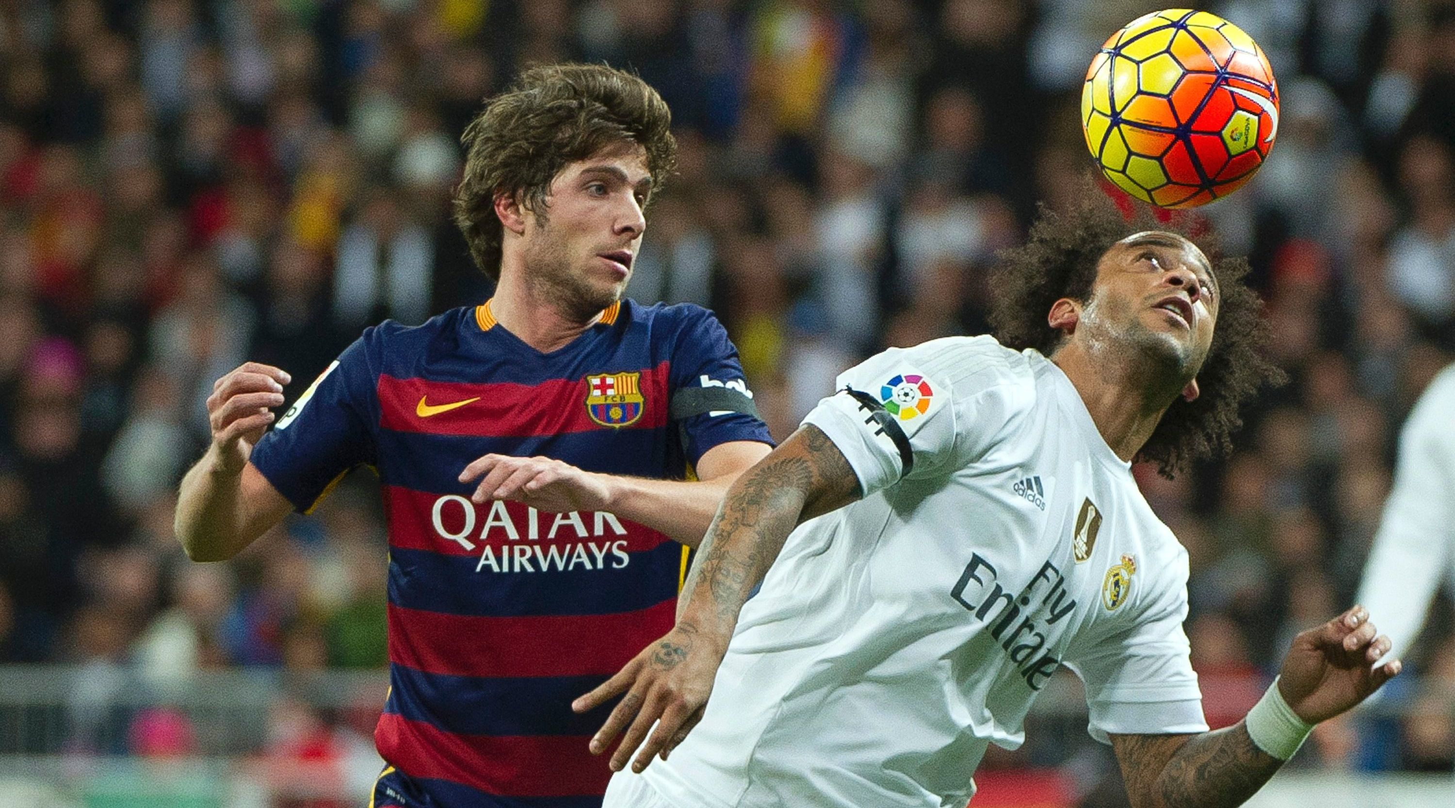 "Real Madrid's Brazilian defender Marcelo (R) vies with Barcelona's midfielder Sergi Roberto during the Spanish league ""Clasico"" football match Real Madrid CF vs FC Barcelona at the Santiago Bernabeu stadium in Madrid on November 21, 2015. AFP PHOTO / CURTO DE LA TORRE / AFP / CURTO DE LA TORRE (Photo credit should read CURTO DE LA TORRE/AFP/Getty Images)"
