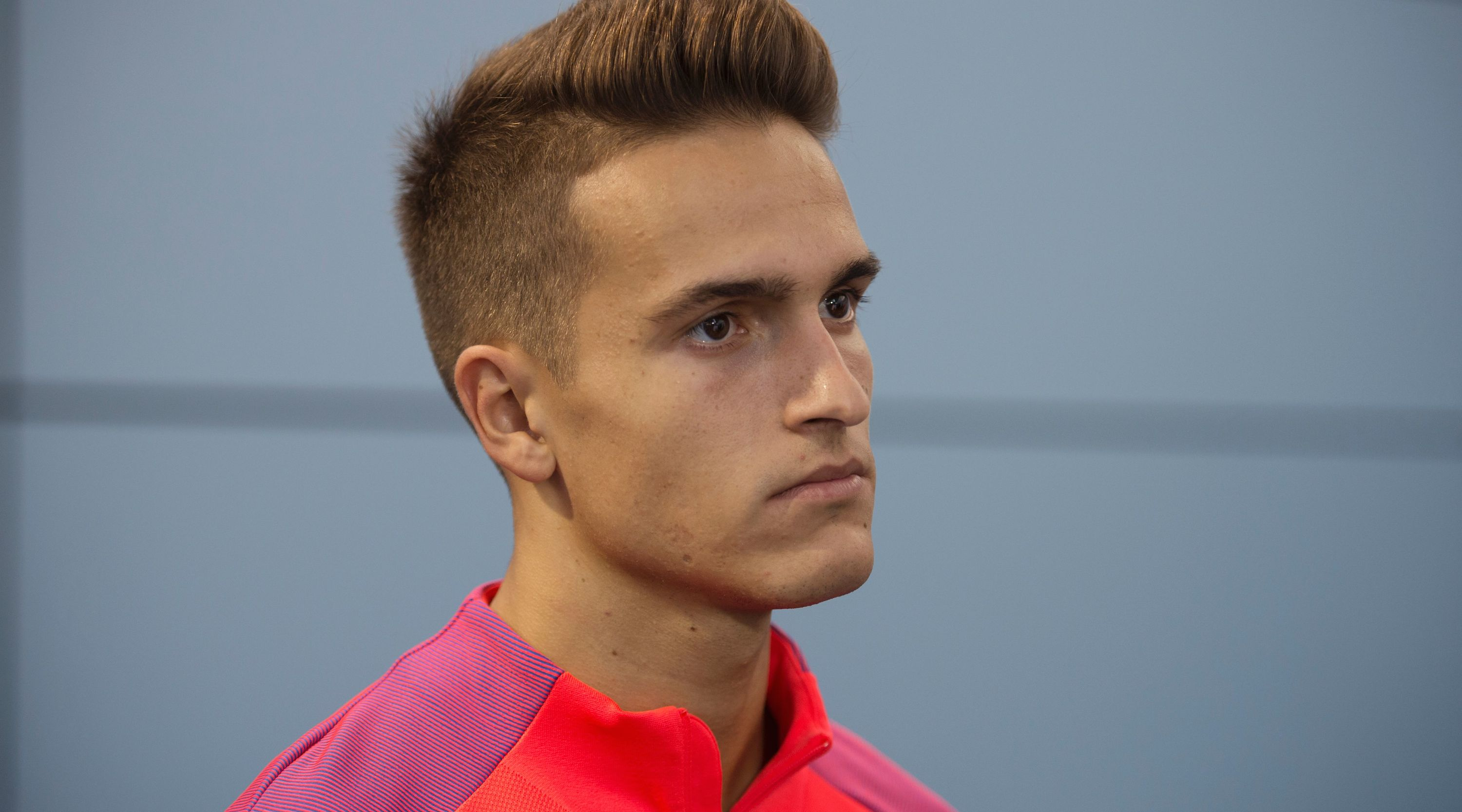 Barcelona's Spanish midfielder Denis Suarez speaks during an interview following a team training session at St George's Park near Burton-on-Trent, central England, on July 26, 2016.