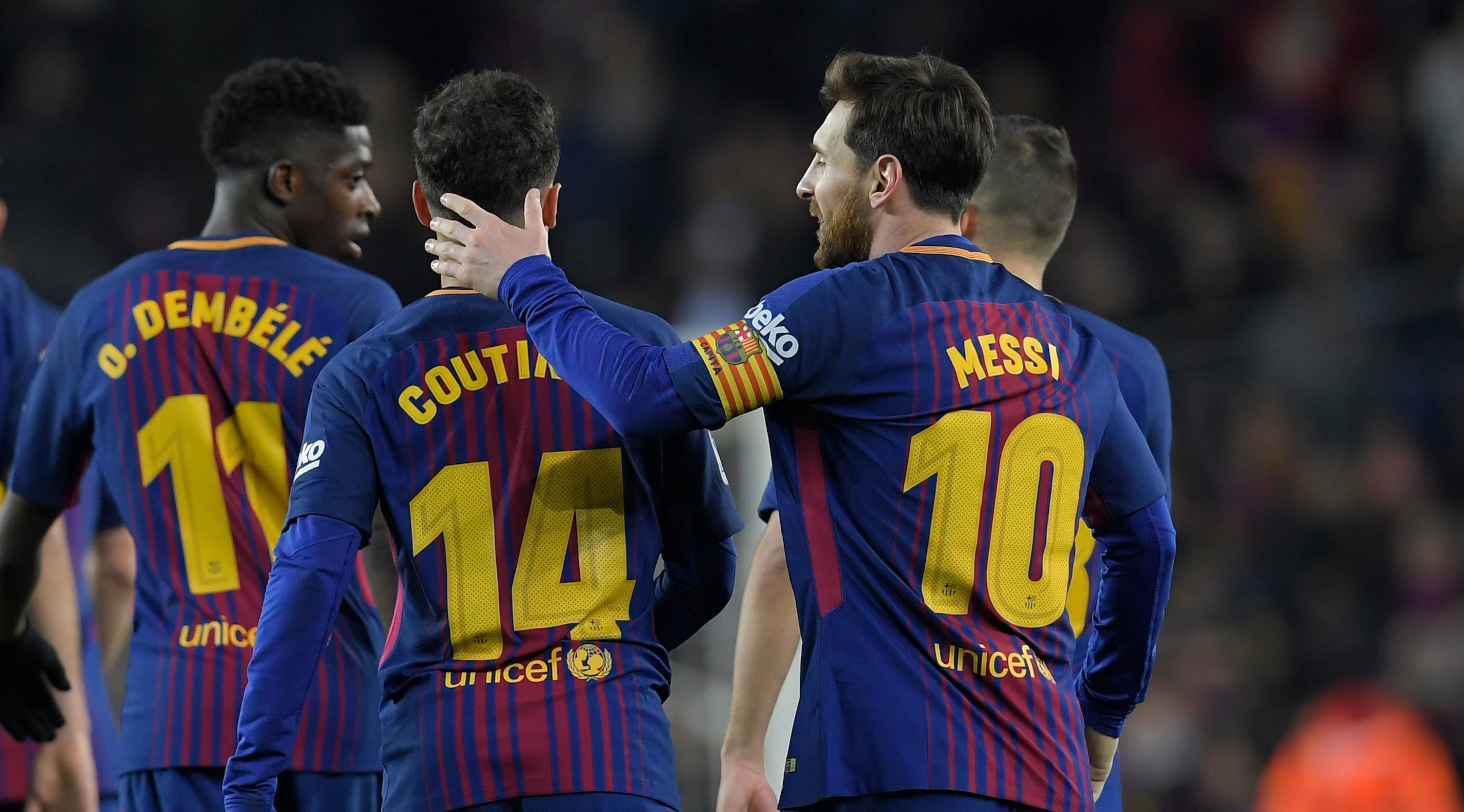 Barcelona's Brazilian midfielder Philippe Coutinho (C) celebrates with Barcelona's Argentinian forward Lionel Messi (R) after scoring during the Spanish league football match between FC Barcelona and Girona FC at the Camp Nou stadium in Barcelona on February 24, 2018. / AFP PHOTO / LLUIS GENE (Photo credit should read LLUIS GENE/AFP/Getty Images)