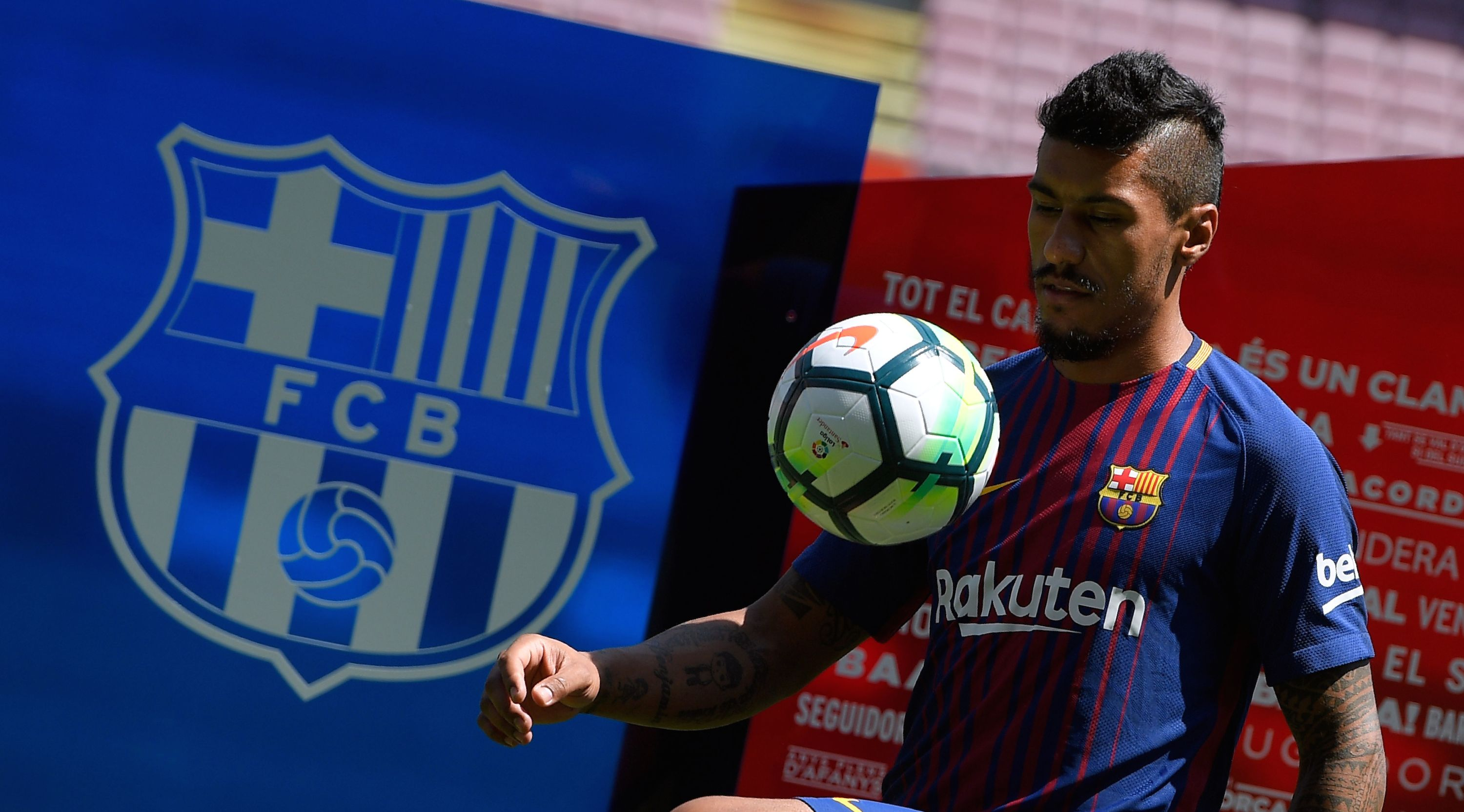 Barcelona's new Brazilian football player Paulinho Bezerra controls a ball during his official presentation, after signing his new contract with the Catalan club at the Camp Nou stadium in Barcelona on August 17, 2017. / AFP PHOTO / LLUIS GENE (Photo credit should read LLUIS GENE/AFP/Getty Images)