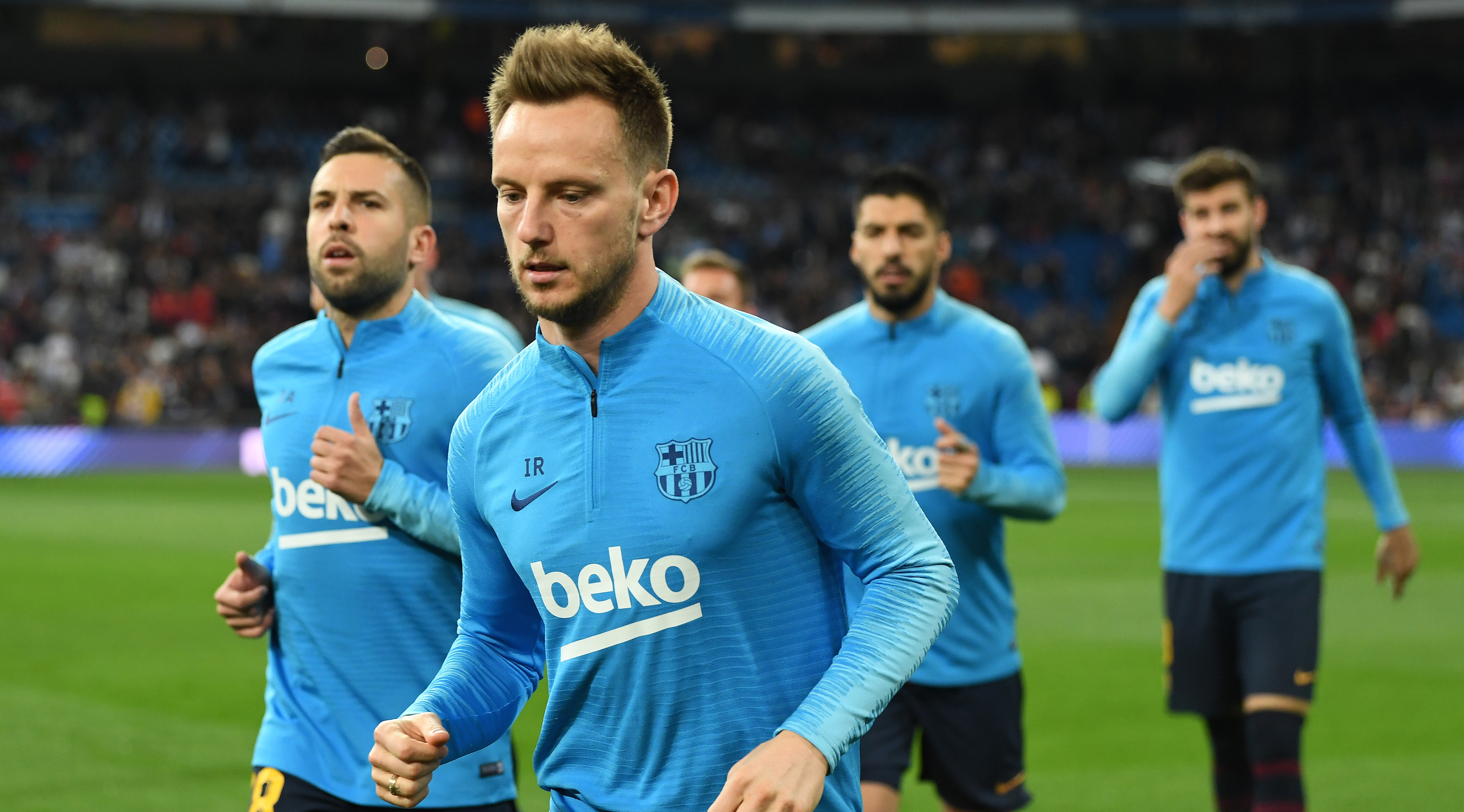 Ivan Rakitic of Barcelona and team mates leave the pitch after the warm ups during the La Liga match between Real Madrid CF and FC Barcelona at Estadio Santiago Bernabeu on March 02, 2019 in Madrid, Spain. (Photo by David Ramos/Getty Images)