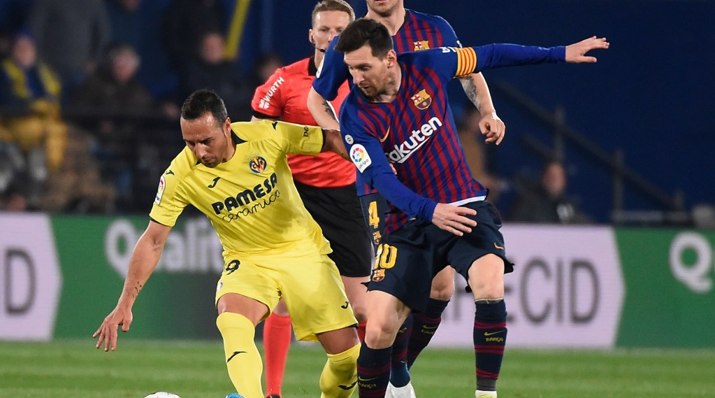Villarreal's Spanish midfielder Santi Cazorla (L) vies with Barcelona's Argentinian forward Lionel Messi during the Spanish league football match Villarreal CF against Barcelona at La Ceramica stadium in Vila-real on April 2, 2019. (Photo by JOSE JORDAN / AFP) (Photo credit should read JOSE JORDAN/AFP/Getty Images)