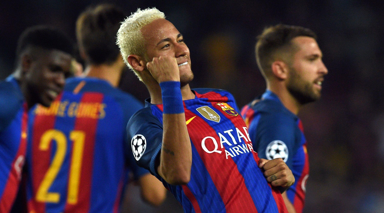 Barcelona's Brazilian forward Neymar celebrates a goal during the UEFA Champions League football match FC Barcelona vs Celtic FC at the Camp Nou stadium in Barcelona on September 13, 2016. / AFP / LLUIS GENE (Photo credit should read LLUIS GENE/AFP/Getty Images)