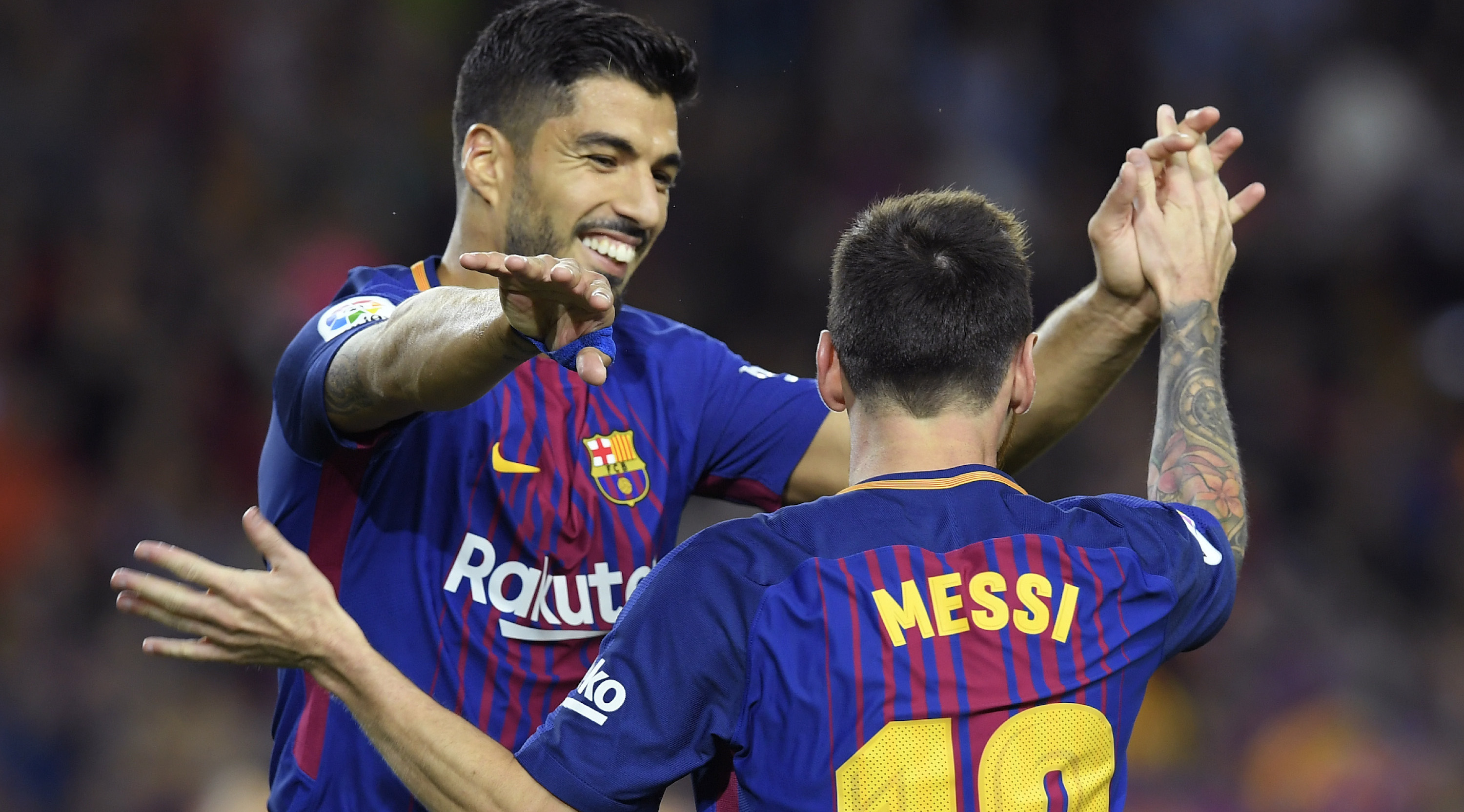 Barcelona's Argentinian forward Lionel Messi (R) celebrates with Barcelona's Uruguayan forward Luis Suarez after scoring during the Spanish Liga football match Barcelona vs Espanyol at the Camp Nou stadium in Barcelona on September 9, 2017. / AFP PHOTO / LLUIS GENE (Photo credit should read LLUIS GENE/AFP/Getty Images)