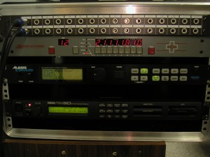 The drum rack unit, which provides a home for the DM5 and the RM-50 computers, plus a MIDI router that is connected to the recording computer plus a few other keyboards and samplers that happen to live in the same area.