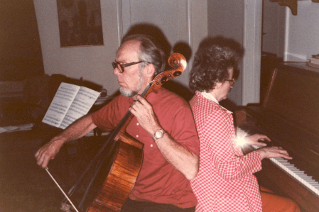 Mom and Dad playing chamber music, one of their favorite pastimes. Hint for photographers... when using a flash make sure that the flash is at the top of the camera to avoid shadows like these. :-)