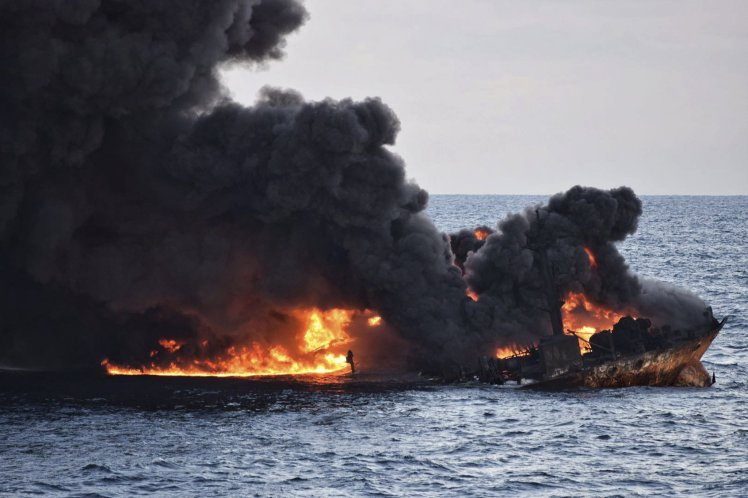 Burning oil tanker sinks off China's eastern coast