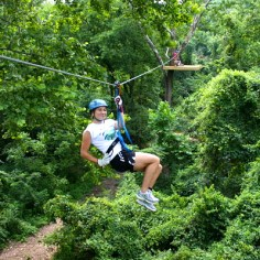 Woman Ziplining at Ozark Mountain Ziplines