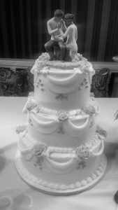 Tiered wedding cake with swag