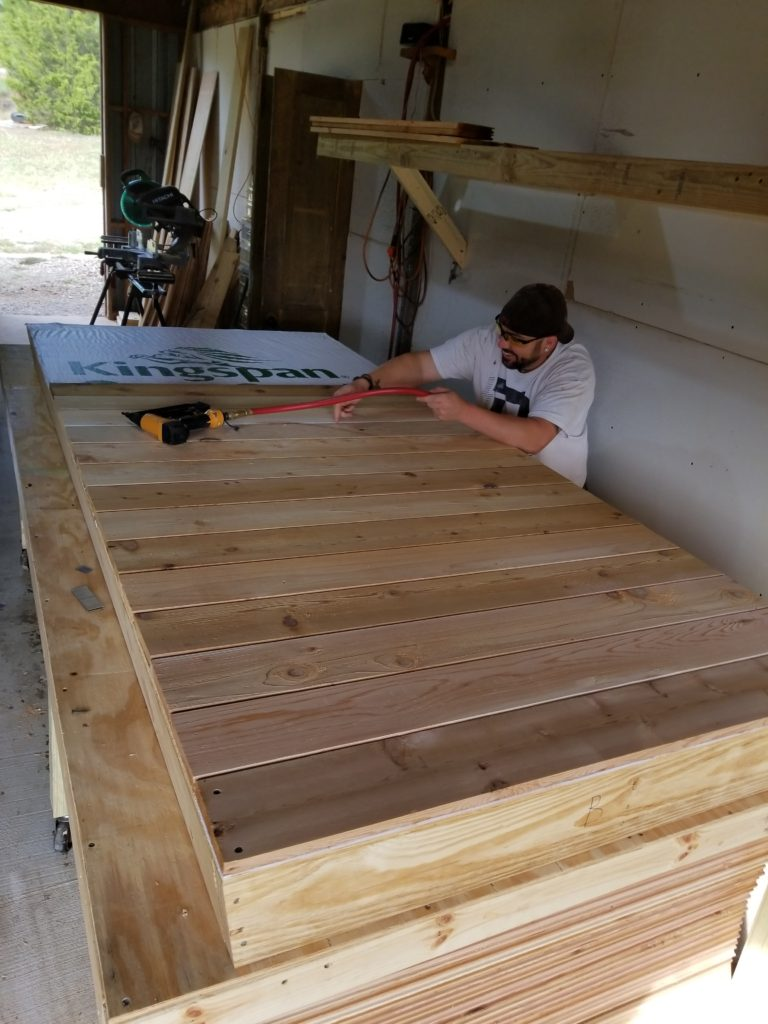 JT adding the western cedar outer sheathing.