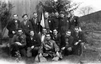 French forced laborers with tricolor following their liberation. The picture shows the complete barrack 7/1 community at the Neindorf satellite plant on April 14, 1945.