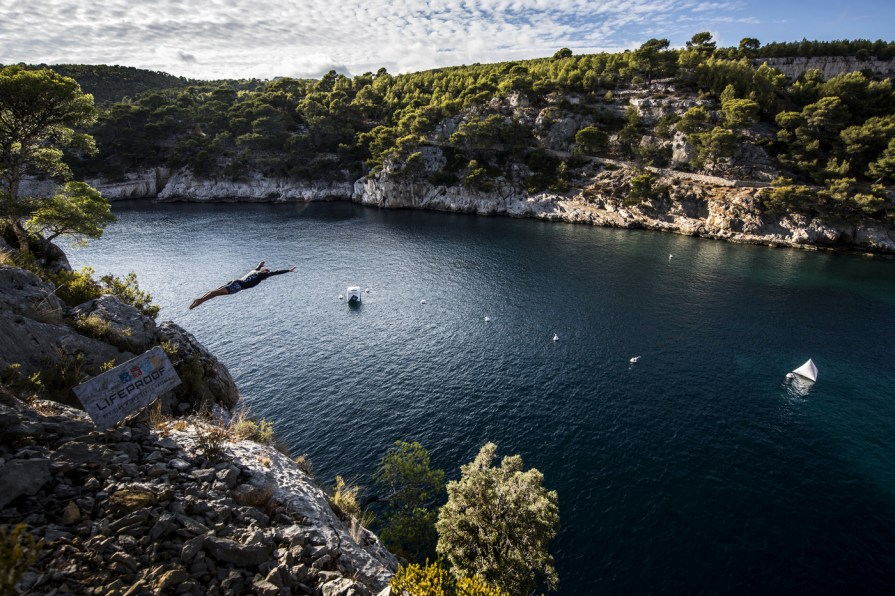 Todor Spasov of Bulgaria dives during a cliff diving trip after the fifth stop of the Red Bull Cliff Diving World Series, in Cote d'Azur, France on September 18, 2017. // Dean Treml/Red Bull Content Pool // AP-1TG1Y1C2W2111 // Usage for editorial use only //