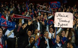 Fans in Paris cheer on the Rouges Eiffels. We'll have to ask our Minsk GM what the sign says.