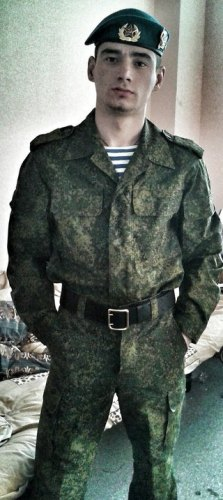 """Gritsyuk posing in his uniform in an album titled """"Army"""""""