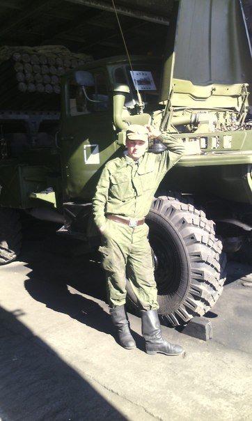 Chugunov posing by a Grad