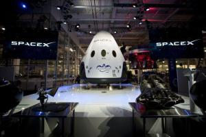 SpaceX's Dragon V2 spacecraft, one of the prime contenders for the NASA contract at its unveiling ceremony in May 2014.