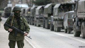 """Trucks with the """"little green men"""" - Russian soldiers hiding their identities and without insignia while annexing the Ukrainian peninsula of Crimea"""