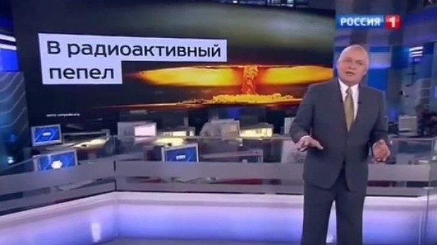 """Dmitry Kiselyov boasting about Russia's ability to turn the US """"into radioactive ash"""" in his program on Russia's premier TV channel. He is the head of the Kremlin's RT (Russia Today) news agency, a propaganda tool to promote the Kremlin's policies, denigrate the West and speculate about Western-led conspiracies as well as attack political opposition to Putin. (Image: screen capture)"""