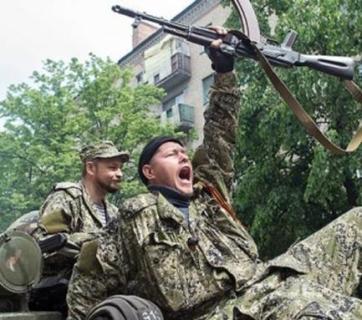 Russian terrorists driving through a Ukrainian city