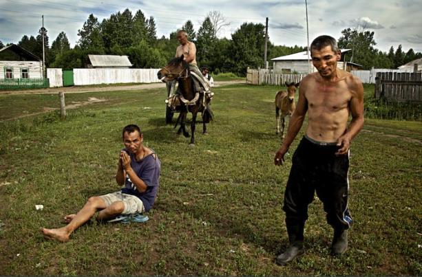 Drunken villagers in southern Siberia, Russia
