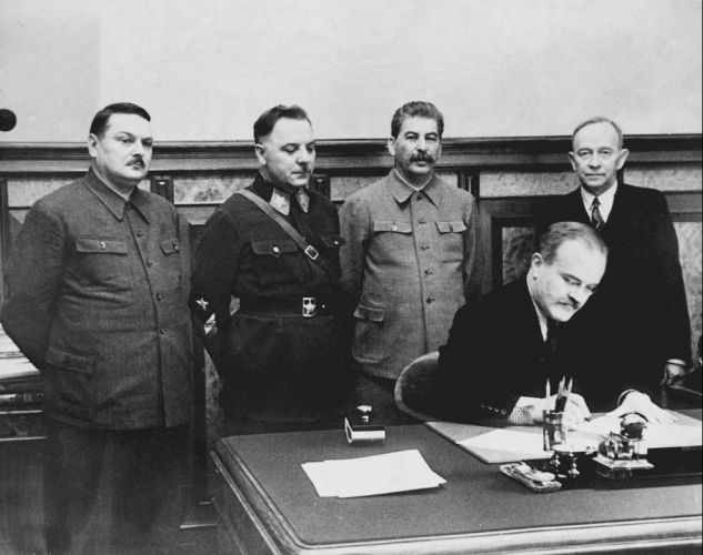 Vyacheslav Molotov signing a deal between the USSR and the Finnish Democratic Republic