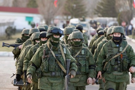 """In a hybrid war operation, Russian """"little green men"""", heavily armed soldiers without insignia, annexed Crimea from Ukraine"""