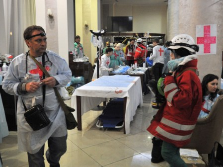 Medics and volunteers arrange a field hospital an hotel hall near Independence square in Kiev on February 20, 2014.