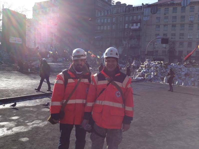 February 2014, Hrushevsky Street, Kyiv, Ukraine. Roman (left) patrolling the Maidan with his close friend Maxim Popov (right). They have known each other for a long time and met again having joined the Red Cross. Maxim Popov was the one who saved injured Roman