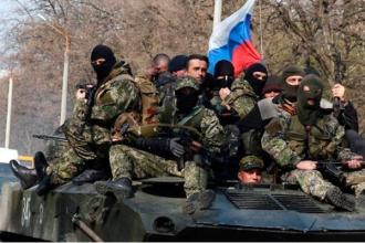 """An armored personnel carrier with Russian """"hybrid"""" military in Donbas, Ukraine (Image: inforesist.org)"""