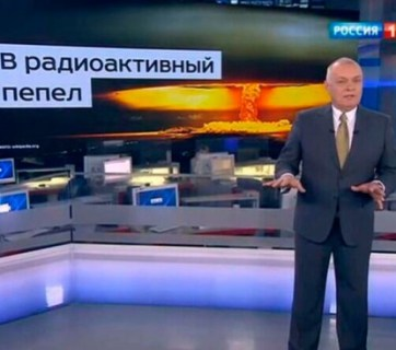 """Head of the Kremlin's Rossiya Segodnya news agency Dmitry Kiselyov projecting the image of a nuclear mushroom cloud and boasting Russia's ability to turn US """"into radioactive ash."""" (Image: screen capture)"""