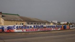 "The sign in Kaluga, Russia says ""Crimea Today - Rome Tomorrow! Happy Victory Day of May 9!"" (Image: KP-Kaluga, May 2015)"
