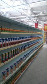 """As tourism to Crimea has undergone a major contraction, a major supermarket chain """"Furshet"""" in Yalta has reduced its inventory to a minimum and fills the empty shelves with bottles of water and drinks one-bottle deep. June 2015. (Image: Twitter)"""
