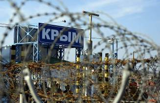 A heavily-protected Russian entry point into the Ukrainian peninsula of Crimea annexed by Russia in March 2014 (Image: Kommersant.ru)