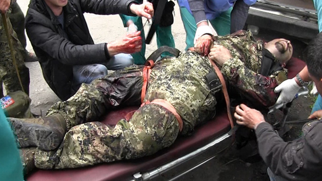 A Russian mercenary in the Donbas with heavily bleeding leg and arm wounds is being evacuated to the rear (Image: censor.net.ua)
