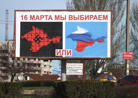 """Moscow propaganda poster plastered all over Crimea before the illegal """"referendum"""" of March 16, 2014."""