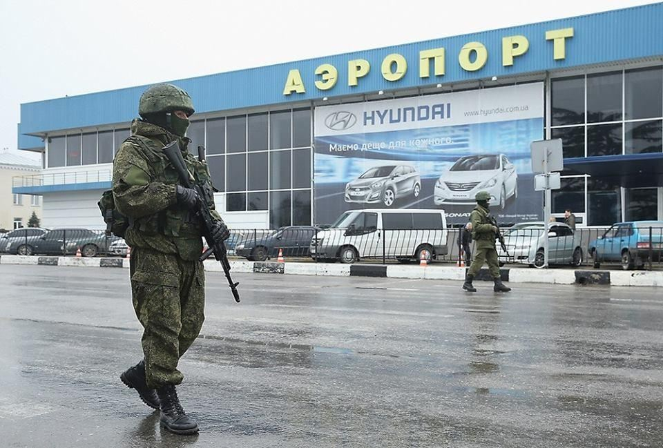 "Russian ""green men"" patrolling the airport in Simferopol, the capitol of Crimea, February 2014. Russian military occupied the peninsula almost a month in advance of the illegal ""referendum."""