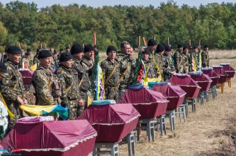 A funeral for unidentified soldiers killed in action liberating the Donbas region of Ukraine from the hybrid army of the Russian Federation. The funeral was held in the town of Kushugum, Zaphorizhze oblast, on October 1, 2014.