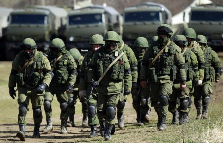 """So-called """"little green men"""" (the Russian occupation troops comprised of special forces who removed insignia, wear face masks to prevent identification and call themselves a """"Crimean self-defense force"""") surround a Ukrainian military base in Perevalne, Crimea, during the Russian annexation of the peninsula in February-March 2014."""