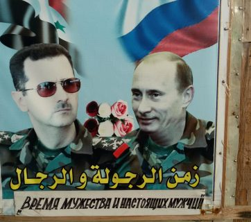 "Poster at a Russian naval base in Tartus, Syria says ""It's time for manliness and real men!"""