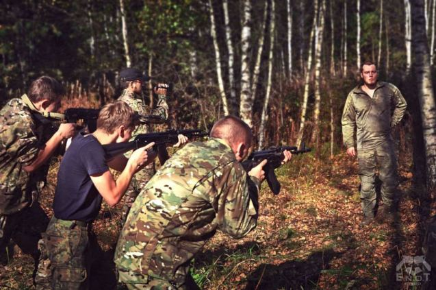 A prominent Russian neo-Nazi Alexey Milchakov (right) instructing at the mercenary camp for Russia's war in Ukraine. Moscow oblast, Russia, September 2015 (Image: ENOT Corp.)