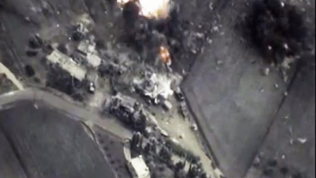 This image from the Russian Defense Ministry shows a Russian Air Force bomb hitting a target in Syria. Khaled Khoja, head of the Syrian National Council opposition group, said at the UN that Russian air strikes killed dozens of civilians, with children among the dead. Photo: AP