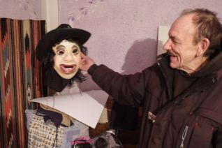 Mykola Marchuk shows off a recent mask