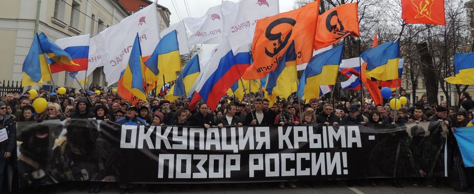 "Boris Nemtsov leads Peace March, March 15, 2014. Banner: ""Russia's Occupation of Crimea is Shameful"" (Source: Facebook)"