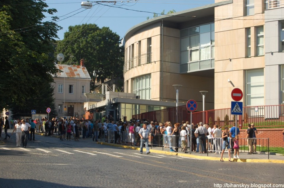 People waiting if a queue to apply for the Schengen visa at the Poland's Consulate in Lviv.