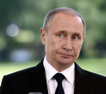 Russia's President Vladimir Putin reacts during a press conference in Finland, Friday, July 1, 2016. ( Jussi Nukari/ Lehtikuva via AP)