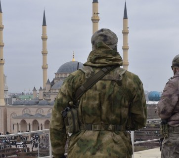 Ramzan Kadyrov's armed men observe the rally in his support in Chechnya's capitol Grozny. January 21, 2016 (Image: Anton Podgaiko/TASS)